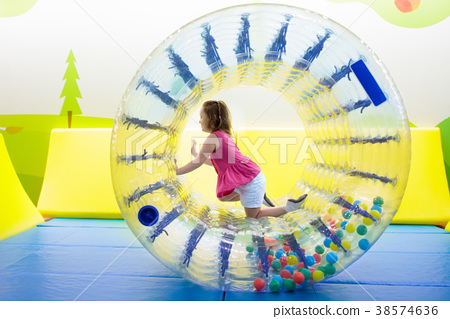Child play in roller wheel. Kids on trampoline. 38574636