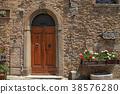 Wooden door in old Italian house, Tuscany, Italy 38576280