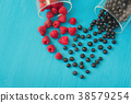 Heart shape of fresh raspberries and blueberries 38579254