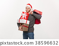 Christmas Concept - young handsome man with beard 38596632
