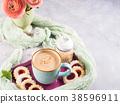 Mug of coffee cookies and flowers 38596911
