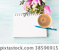 Blank notebook page with blue pen and cup coffee 38596915