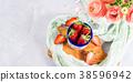 Ripe strawberries in enamel mug 38596942
