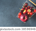 Fresh red fruit berries supermarket cart on black 38596946