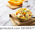 Vegan salad with melon and tofu cheese 38596977
