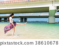 young lady playing in Naminoue Beach. 38610678