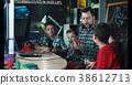 Teacher with kids exploring 3d printing 38612713