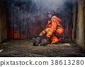 Firefighters save unconscious man from burnt place 38613280