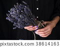 Female florist tying  fresh bouquet with lavender 38614163