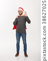 Christmas concept - Young confident smart man 38627025