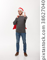 Christmas concept - Young confident smart man 38627040