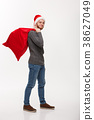 Christmas concept - Young confident smart man 38627049