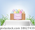 colorful Easter eggs in a basket with grass 38627439