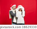 Christmas concept - Portrait of a romantic young 38629330
