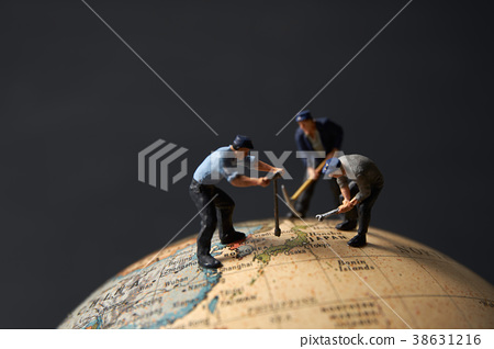 Globe and miniature doll workers 38631216