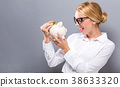 Young woman with a piggy bank 38633320