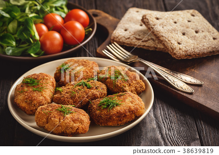 Fried meat cutlets, tomatoes and salad. 38639819