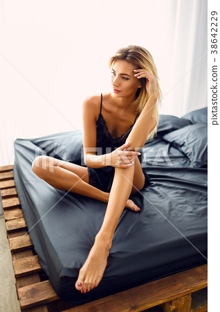 Natural pretty blonde sitting on bed 38642229