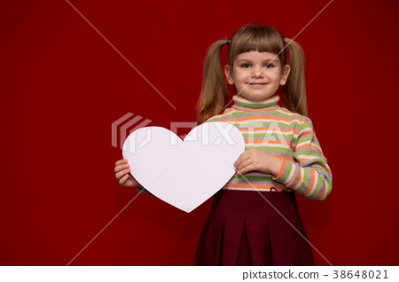 little girl hold white paper heart isolated on red 38648021