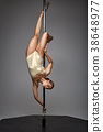 beautiful pole dancer in golden bodywear on pylon 38648977