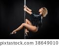 beautiful pole dancer in leather jacket on pylon 38649010