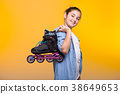 Smilig cute young girl holding a roller in hands 38649653