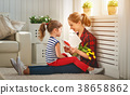 Happy mother's day! Child daughter congratulates moms and gives 38658862