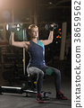 Young woman lifting the dumbbells 38659562