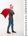 Christmas concept - Young confident smart man 38664424
