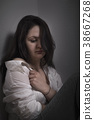 Sad woman pulling her shirt 38667268