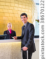 Hotel receptionist check in man giving key card 38670122