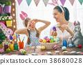 Family preparing for Easter 38680028