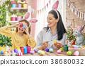 Family preparing for Easter 38680032