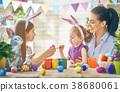 Family preparing for Easter 38680061