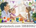 Family preparing for Easter 38680062