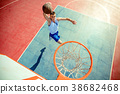 High angle view of basketball player dunking 38682468