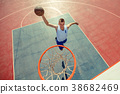 High angle view of basketball player dunking 38682469