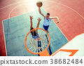 High angle view of basketball player dunking 38682484