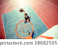 High angle view of basketball player dunking 38682505