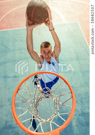 High angle view of basketball player dunking 38682507