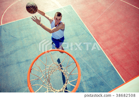 High angle view of basketball player dunking 38682508