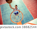 High angle view of basketball player dunking 38682544