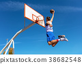 Young Basketball street player making slam dunk 38682548