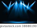 Blue spotlight strike through the darkness. 38686190