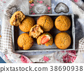 Peanut butter muffins with strawberry jam 38690938