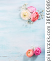 Beautiful flower frame bouquet on turquoise 38690986