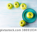 Green pastel background with apples. Healthy food 38691034