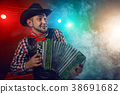 The actor plays the accordion. 38691682