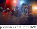 Teenagers are playing rock. 38691694