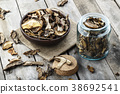 dried mushrooms on a wooden background 38692541